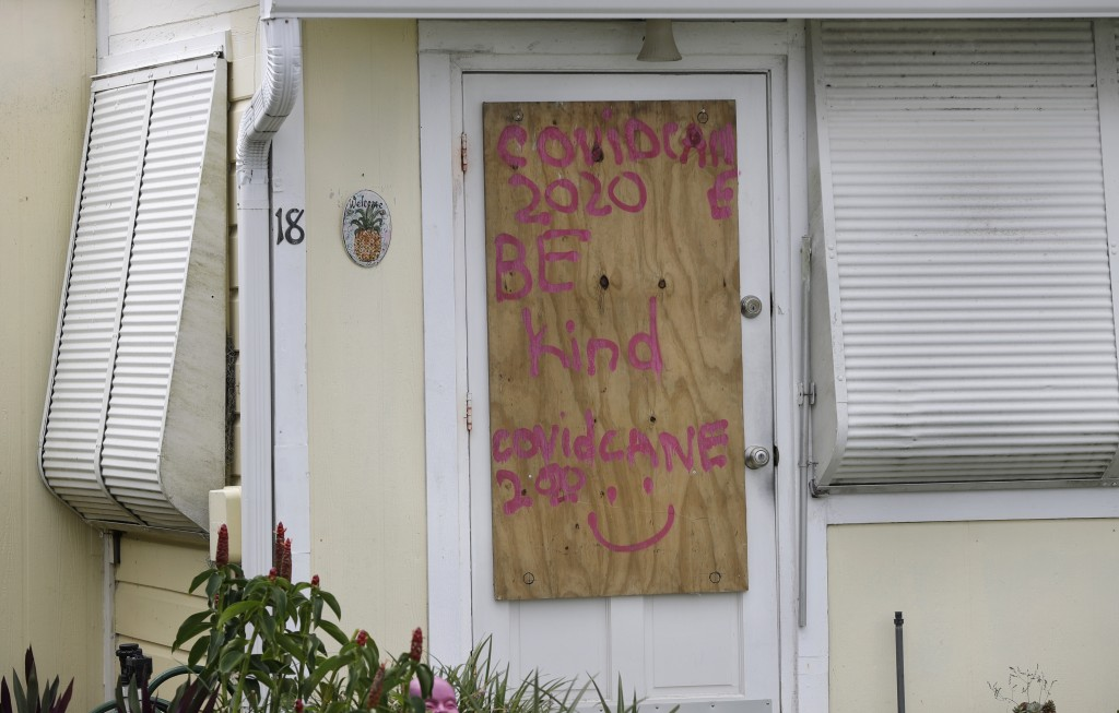 A boarded up home is shown, Saturday, Aug. 1, 2020, in Briny Breezes, Fla. Hurricane Isaias has snapped trees and knocked out power while blowing thro...