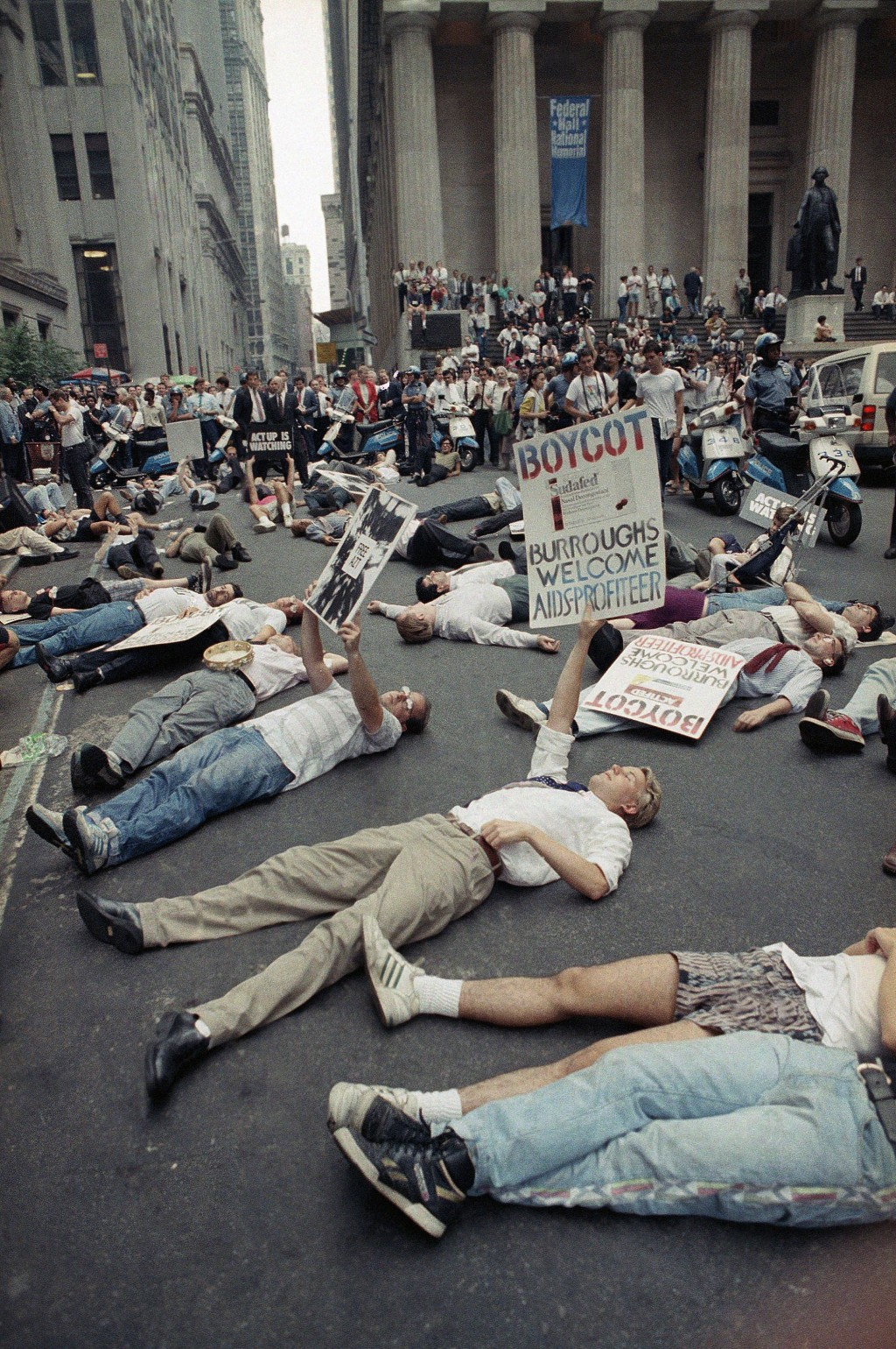 FILE - In this Thursday, Sept. 14, 1989 file photo, protestors lie on the street in front of the New York Stock Exchange in a demonstration against th...