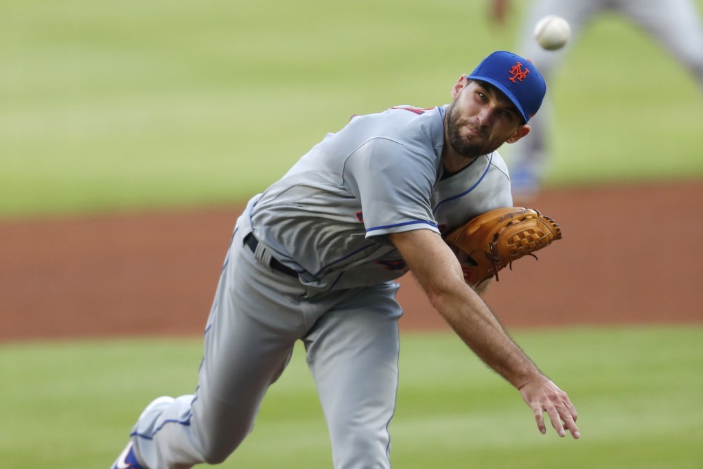 New York Mets starting pitcher Michael Wacha works in the first inning of the team's baseball game against the Atlanta Braves on Saturday, Aug. 1, 202...