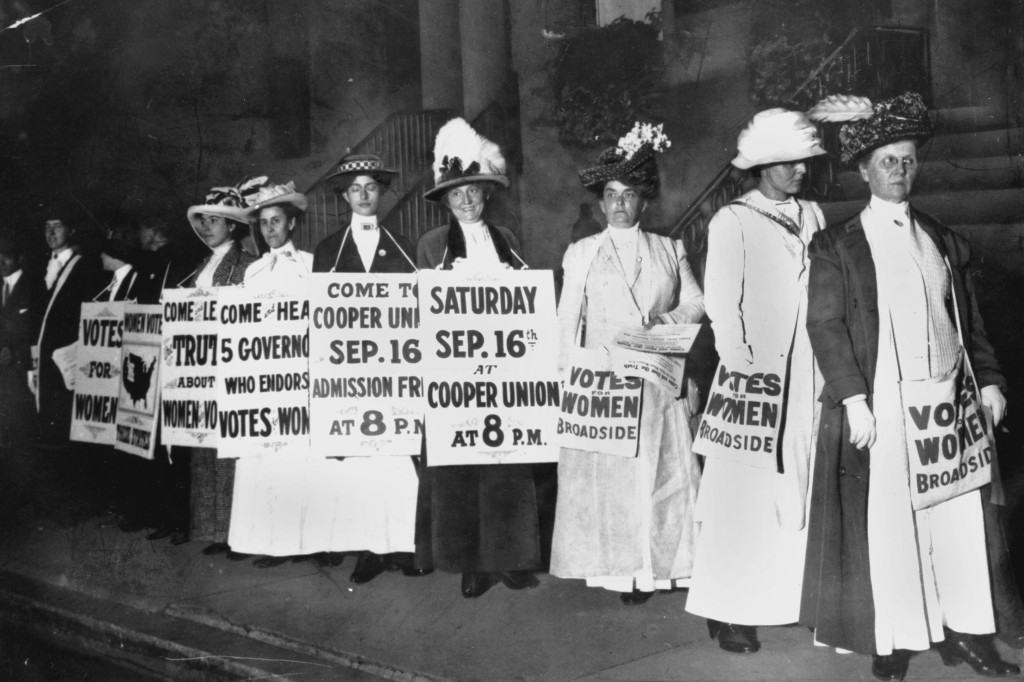 FILE - In this September 1916 file photo, demonstrators hold a rally for women's suffrage in New York. The Seneca Falls convention in 1848 is widely v...