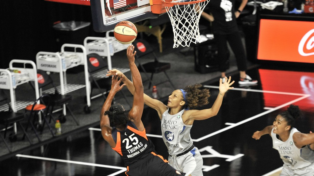 Connecticut Sun's Alyssa Thomas (25) shoots under pressure from Minnesota Lynx's Mikiah Herbert Harrigan during the first half of a WNBA basketball ga...