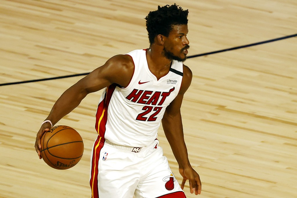 Miami Heat's Jimmy Butler dribbles up court during the first half of an NBA basketball game against the Denver Nuggets, Saturday, Aug. 1, 2020, in Lak...