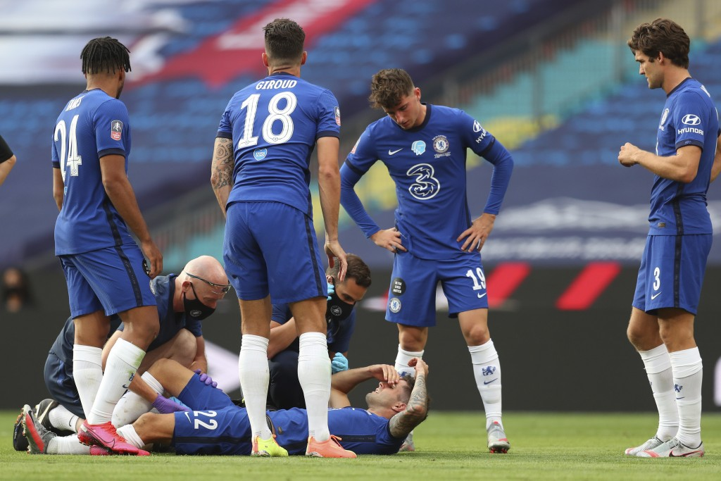 Chelsea's Christian Pulisic is injured during the FA Cup final soccer match between Arsenal and Chelsea at Wembley stadium in London, England, Saturda...