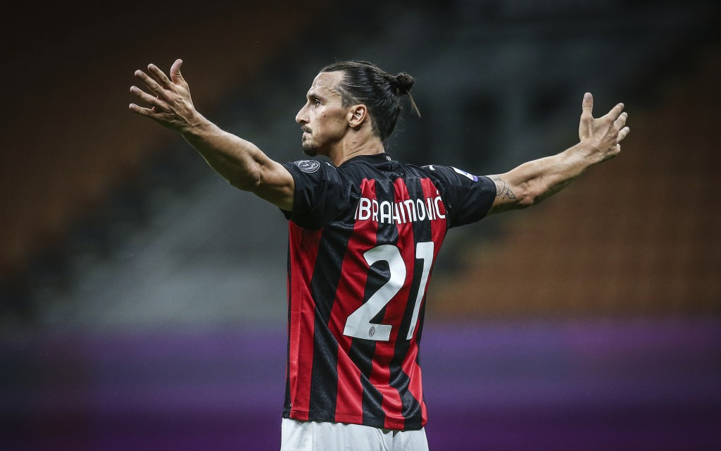Milan's Zlatan Ibrahimovic celebrates after scoring the second goal during a Serie A soccer match between Milan and Cagliari, at the Giuseppe Meazza s...
