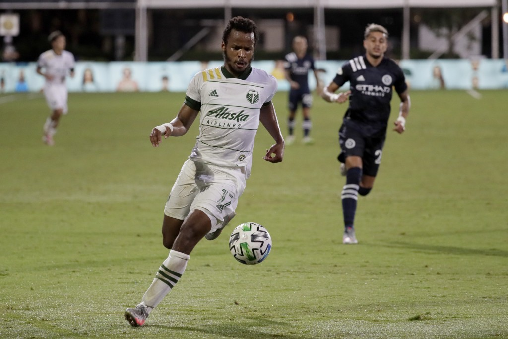 Portland Timbers forward Jeremy Ebobisse moves the ball down field against the New York City during the first half of an MLS soccer match, Saturday, A...