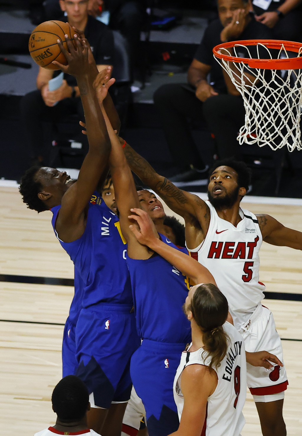 Denver Nuggets' Bol Bol (10) and PJ Dozier (35) battle for a rebound against Miami Heat's Derrick Jones Jr. (5) and Kelly Olynyk (9) during an NBA bas...
