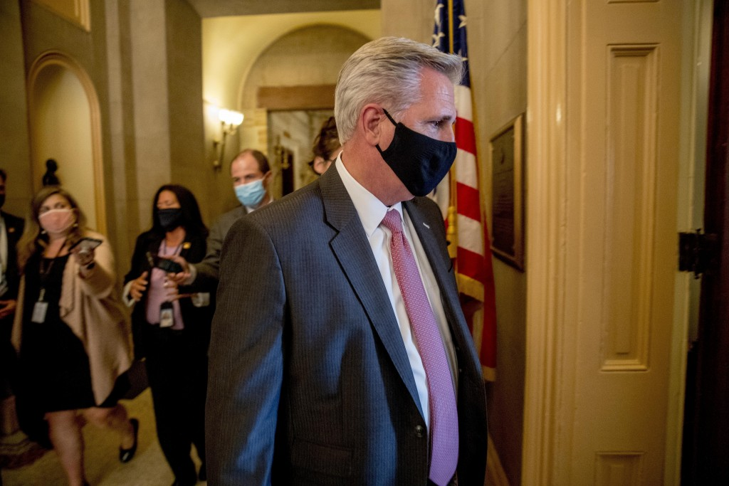 FILE - In this July 29, 2020, file photo House Minority Leader Kevin McCarthy of Calif., walks into a meeting with Republican lawmakers on Capitol Hil...