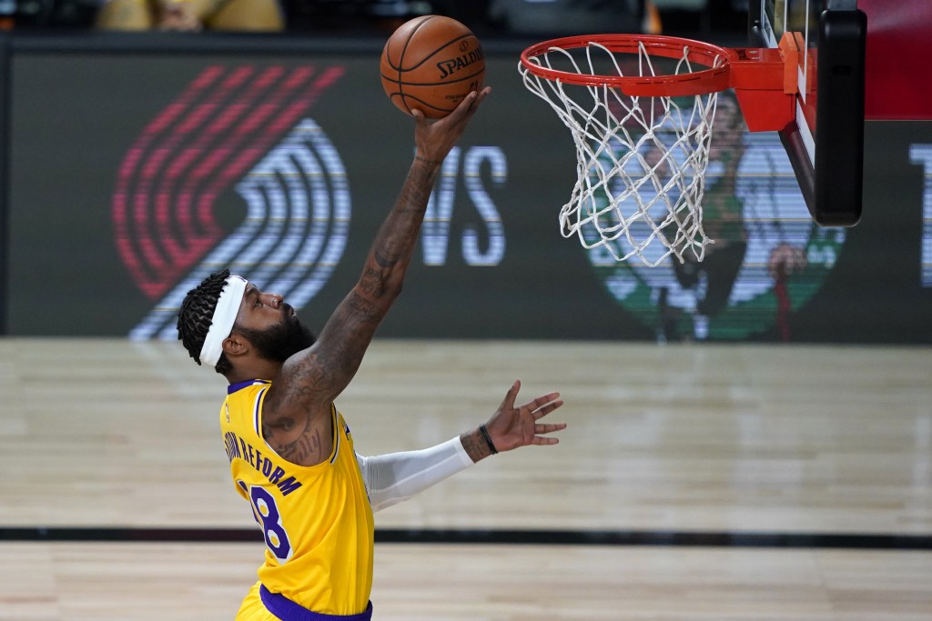 Los Angeles Lakers' Markieff Morris shoots against the Toronto Raptors during the first half of an NBA basketball game Saturday, Aug. 1, 2020, in Lake...