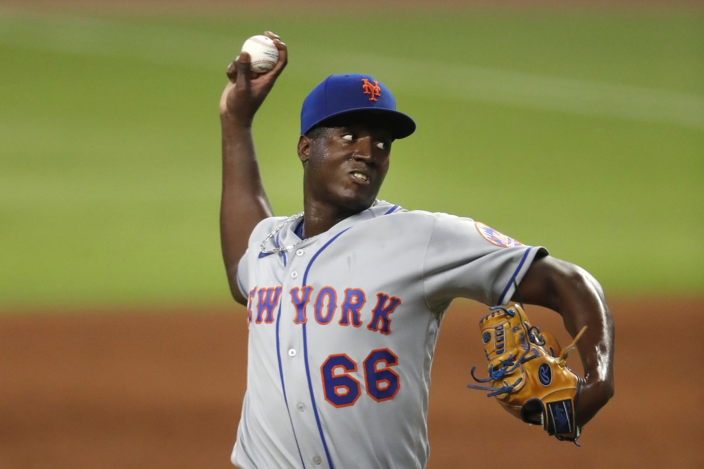 New York Mets relief pitcher Franklyn Kilome works in the sixth inning of the team's baseball game against the Atlanta Braves on Saturday, Aug. 1, 202...