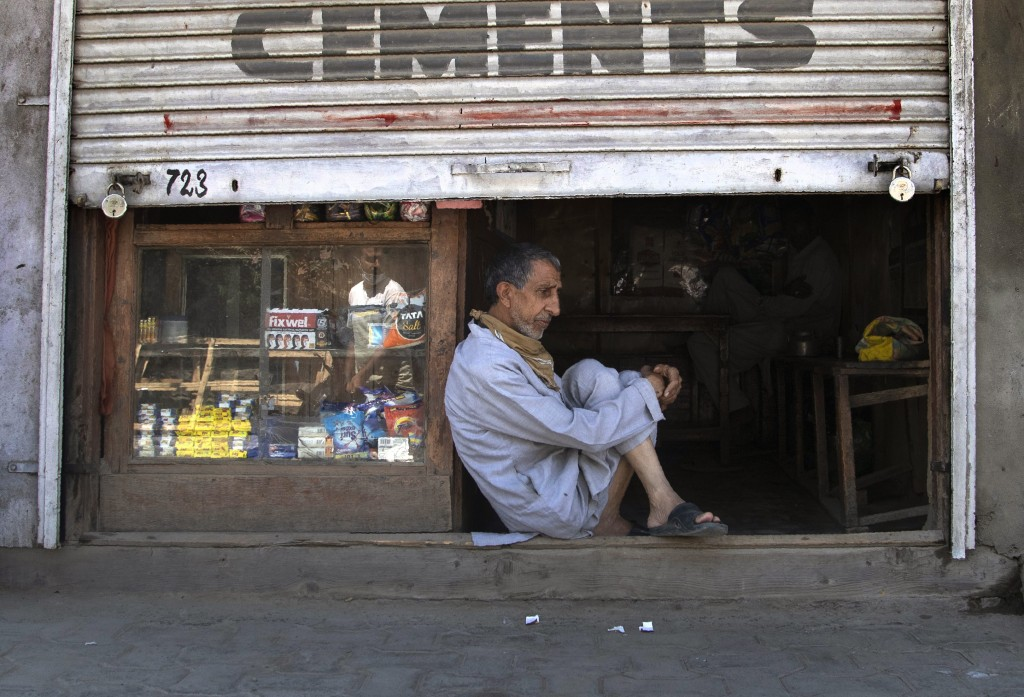 A Kashmiri shopkeeper sits at the entrance of his half closed shop during lockdown in Srinagar, Indian controlled Kashmir, July 27, 2020. Indian-contr...