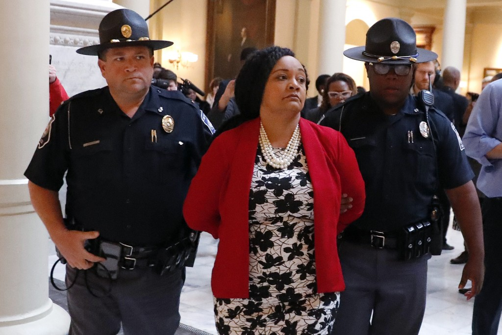 FILE - In this Tuesday, Nov. 13, 2018 file photo, Sen. Nikema Williams, D-Atlanta, is detained by capitol police during a protest over election ballot...