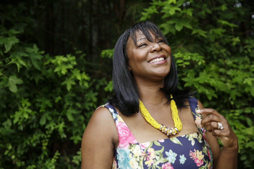 """Chinita Allen poses for a portrait on Friday, July 24, 2020, in Marietta, Ga. """"It's all about knowing your worth,"""" she said of her political evolution..."""