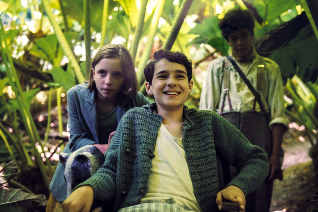 """This image released by STXfilms shows Dixie Egerickx, Edan Hayhurst and Amir Wilson in a scene from """"The Secret Garden.""""  (STXfilms via AP)"""