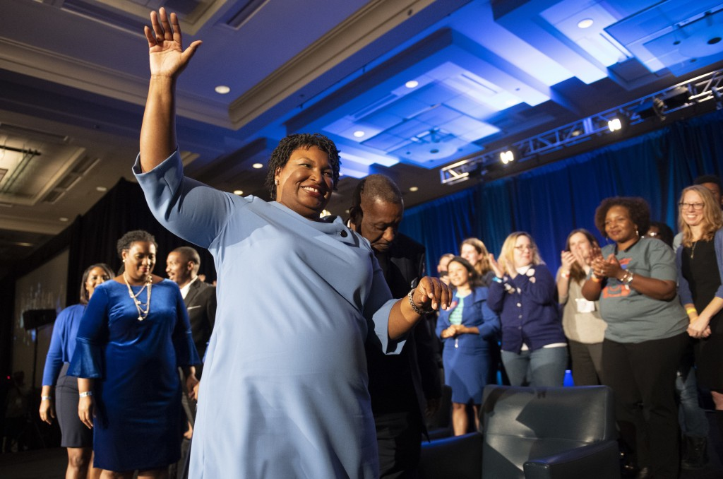 FILE - In this Tuesday, Nov. 6, 2018 file photo, Georgia Democratic gubernatorial candidate Stacey Abrams leaves the stage after addressing supporters...