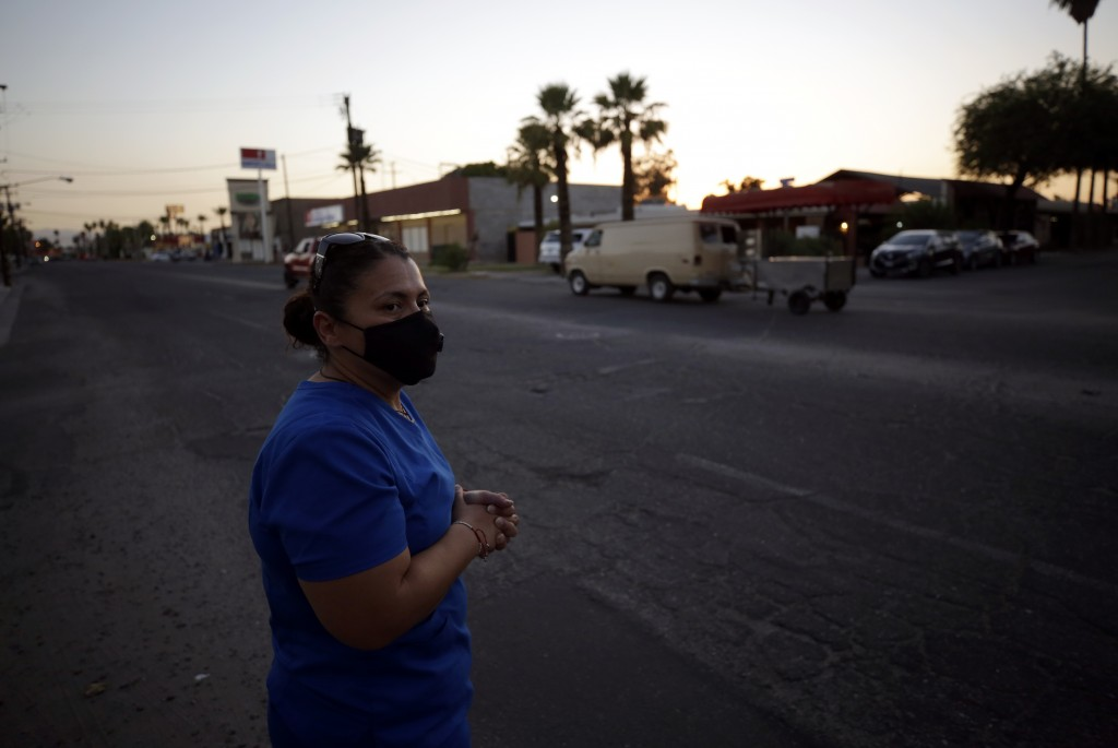 Dulce Garcia looks out on a street near her home Wednesday, July 22, 2020, in Mexicali, Mexico. Garcia, who was born in Mexico and settled with her fa...