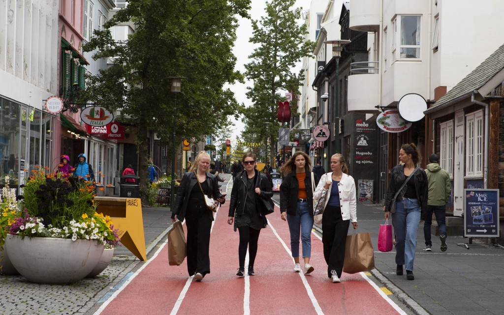 A group of women walk down Laugavegur, the main shopping street in Reykjavik, Iceland Saturday Aug. 1, 2020. In Iceland, a nation so safe that its pre...