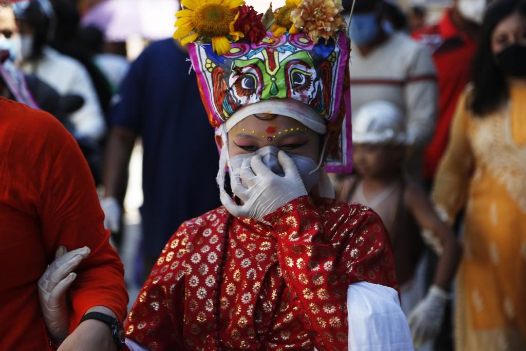Child participates inprocession during 'Gai Jatra,'or cow festival, in Kathmandu, Nepal.