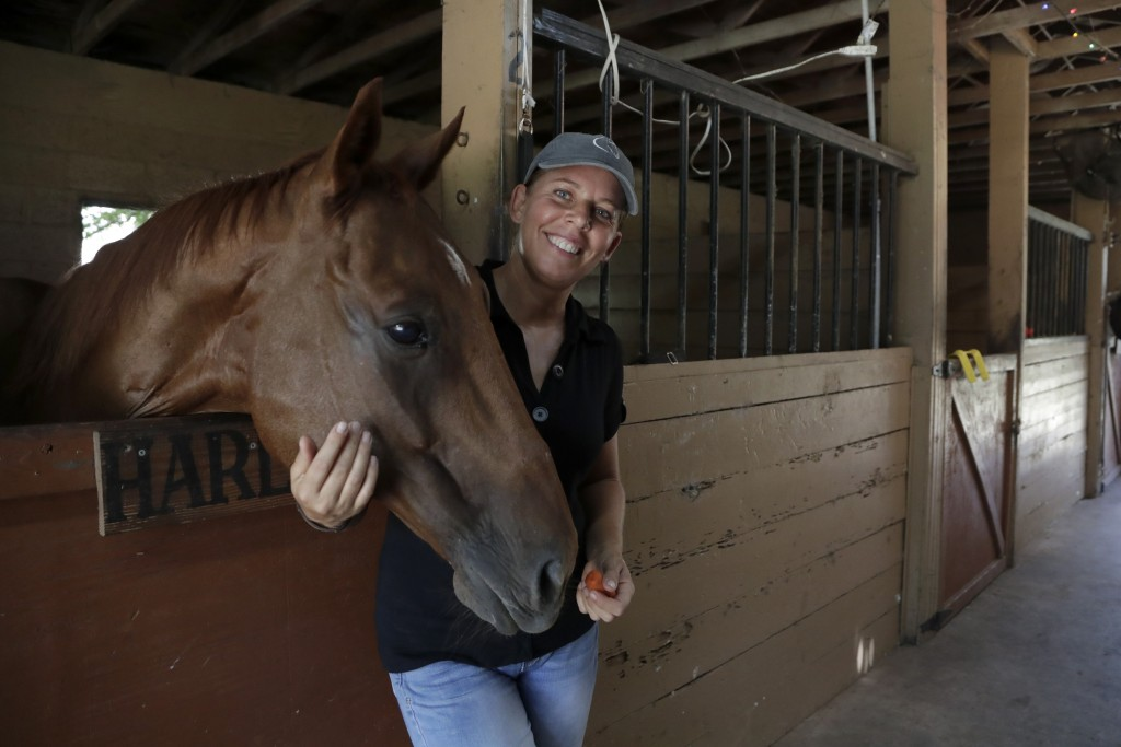 Timea Hunter poses for a photograph at the Family Horse Academy, where she is hoping to organize education for a group of children during the coronavi...