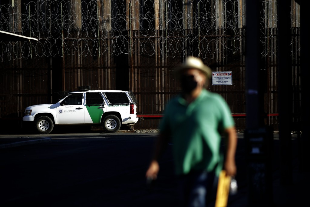 A Border Patrol vehicle sits near the border wall separating Mexicali, Mexico from Calexico, Calif., Tuesday, July 21, 2020, in Calexico. The city of ...