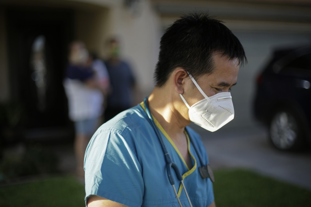 Dr. Tien Vo goes to leave after talking with a family quarantining after they tested positive for the coronavirus Thursday, July 23, 2020, in Calexico...