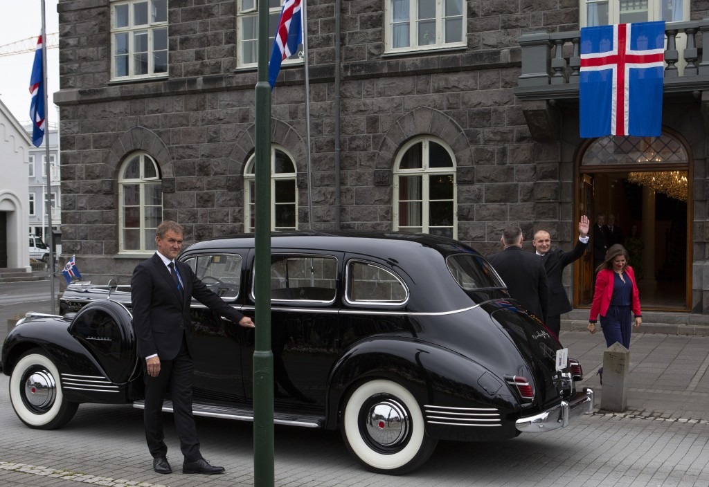 Iceland's president Guðni Th. Jóhannesson waves as he gets into a car following his inauguration in Reykjavik, Iceland Saturday Aug. 1, 2020. In Icela...