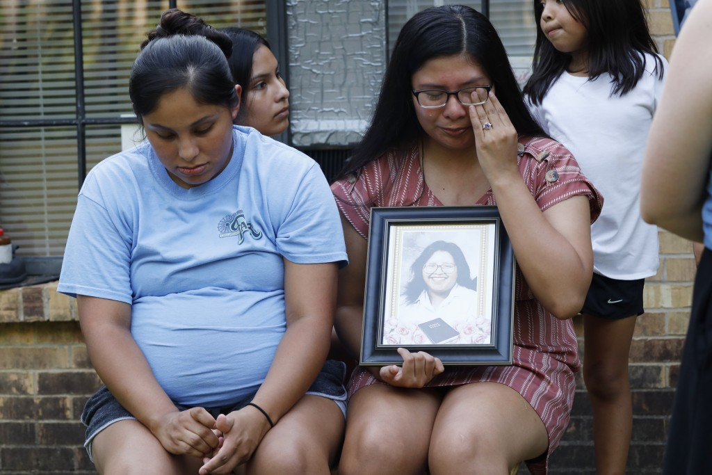 Kristina Taylor, 18, cries as she holds a portrait of her late mother, Sharon Taylor, while she and her older sister Kristi Wishork, 25, recall the ca...