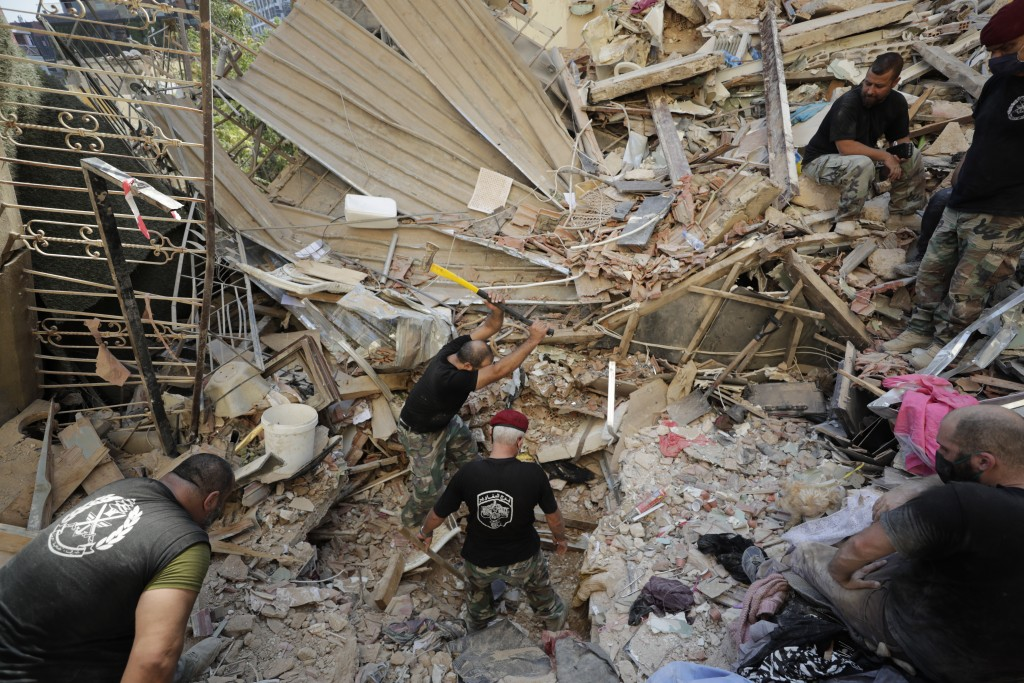 Lebanese soldiers search for survivors after a massive explosion in Beirut, Lebanon, Wednesday, Aug. 5, 2020. The explosion flattened much of a port a...