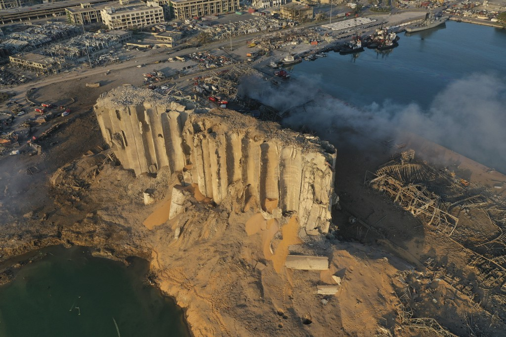 In this drone picture, the destroyed silo sits in rubble and debris after an explosion at the seaport of Beirut, Lebanon, Lebanon, Wednesday, Aug. 5, ...