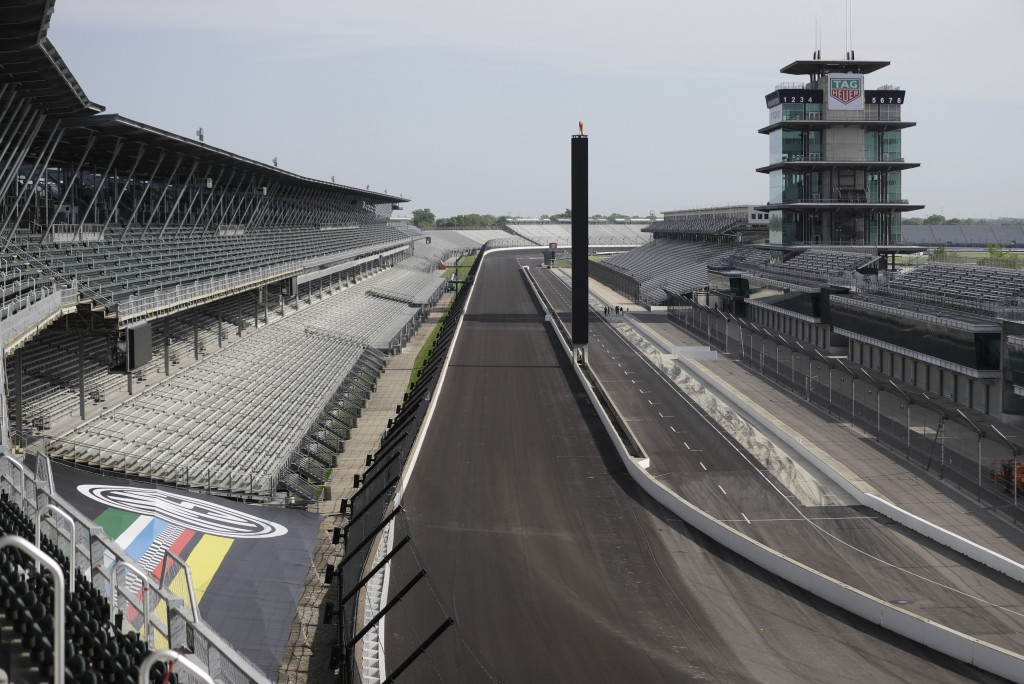 FILE - In this May 24, 2020, file photo, Indianapolis Motor Speedway sits empty in Indianapolis. Roger Penske has reversed course and decided not to a...