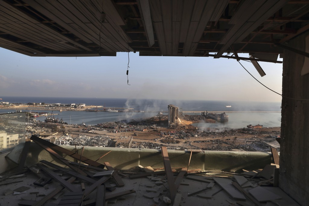 This photo shows a general view of the scene of an explosion that hit the seaport of Beirut, Lebanon, Wednesday, Aug. 5, 2020. A massive explosion roc...