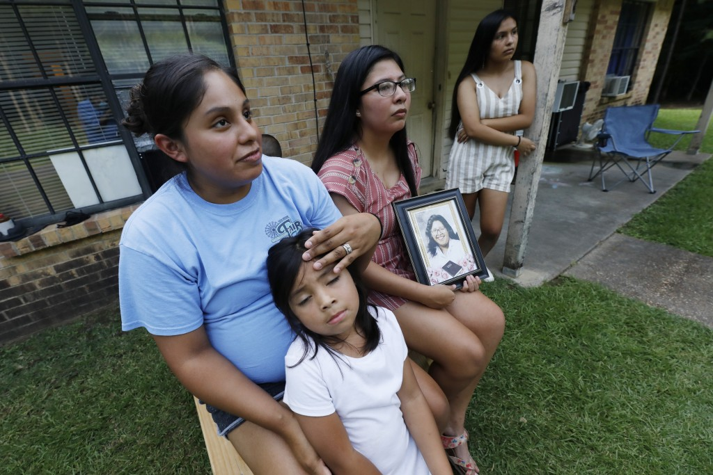 Sisters Kristi Wishork, left, consoles her daughter Renaya Farmer, 5, as she and her sisters Kristina Taylor, center and Kaydee Taylor, right recall t...