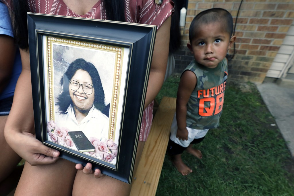 Kristina Taylor, 18, holds a portrait of her late mother, Sharon Taylor, while nephew Xavier Wishork, 2, stands at attention, Tuesday, July 22, 2020 i...
