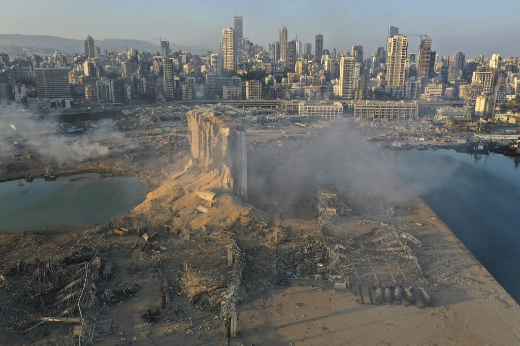 A drone picture shows the scene of an explosion at the seaport of Beirut, Lebanon, Wednesday, Aug. 5, 2020. A massive explosion rocked Beirut on Tuesd...