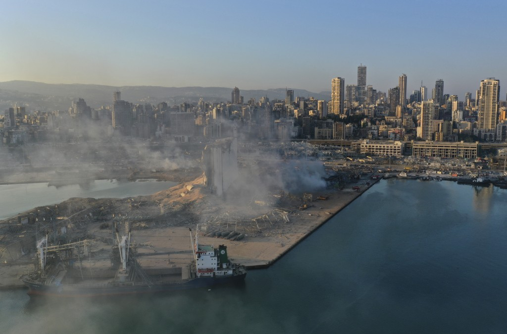 A drone picture shows smoke from the scene of an explosion at the seaport of Beirut, Lebanon, Wednesday, Aug. 5, 2020. A massive explosion rocked Beir...