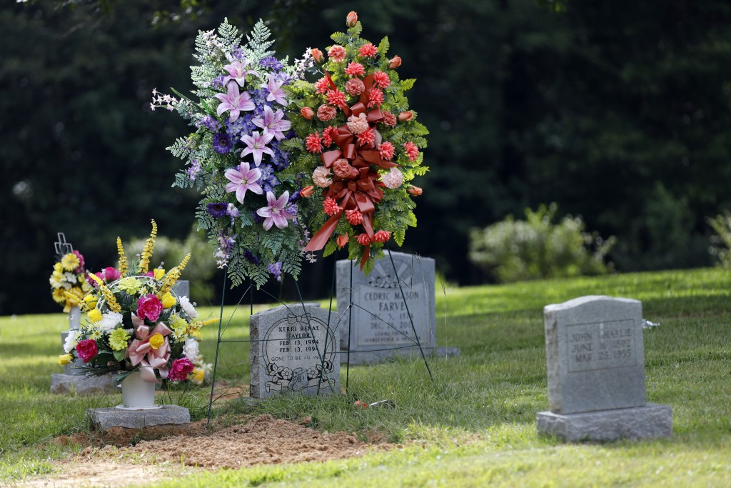 Flowers decorate the Tucker, Miss., grave of Sharon Taylor, mother of Choctaw Central High School's valedictorian Kristina Taylor, and one of several ...