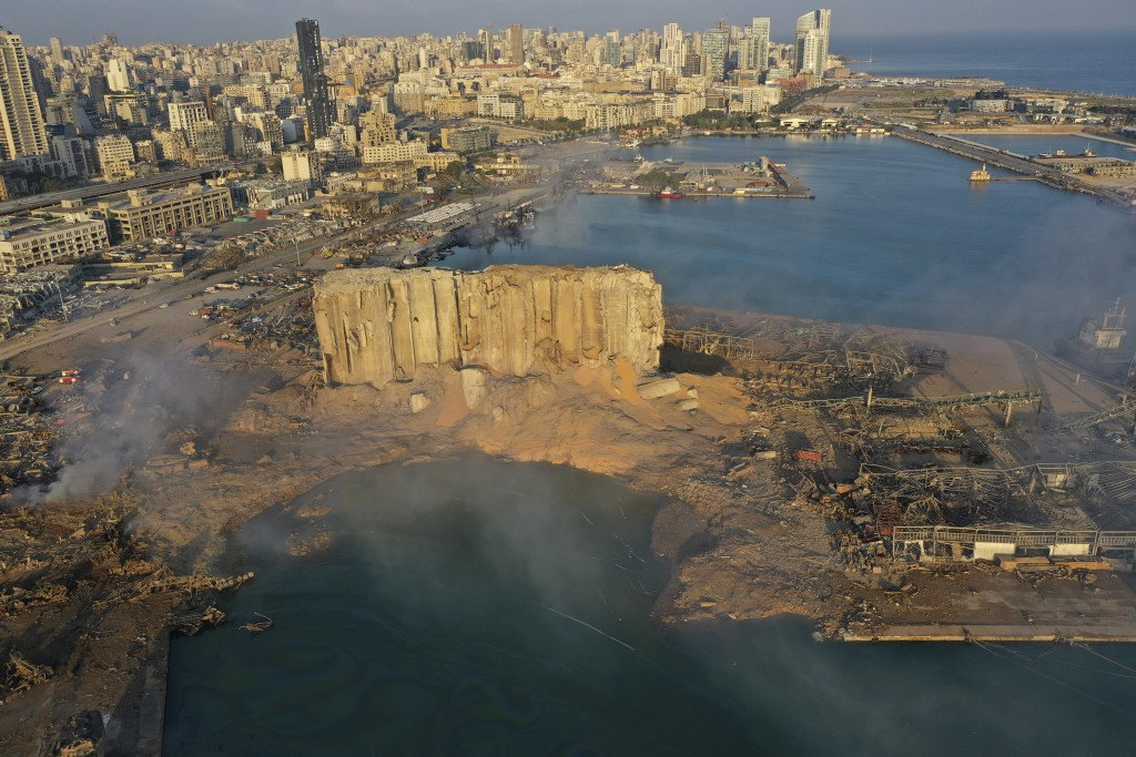 A drone picture shows the scene of an explosion that hit the seaport of Beirut, Lebanon, Wednesday, Aug. 5, 2020. A massive explosion rocked Beirut on...