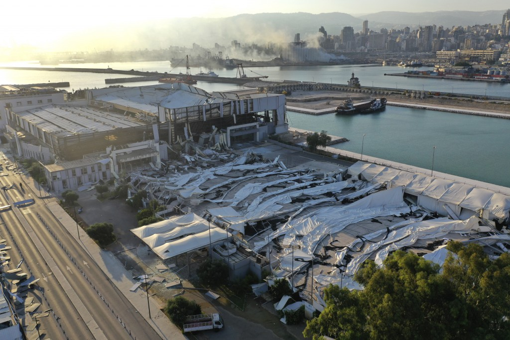 This drone pictures shows a destroyed events and exhibition hall near the scene of an explosion that hit the seaport of Beirut, Lebanon, Wednesday, Au...