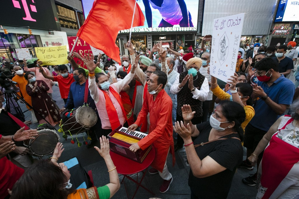 People gather in Times Square on Wednesday, Aug. 5, 2020, in New York after the groundbreaking ceremony of a temple being built on disputed ground in ...