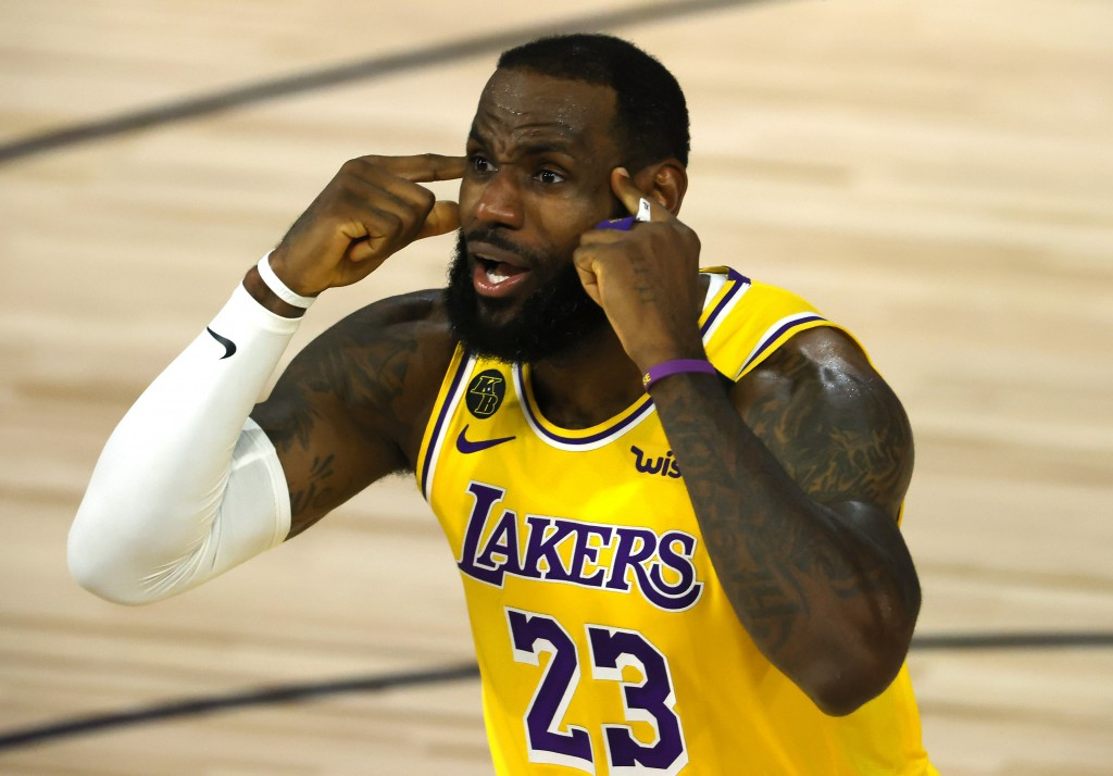 LeBron James of the Los Angeles Lakers reacts against the Oklahoma City Thunder during the second quarter during an NBA basketball game Wednesday, Aug...