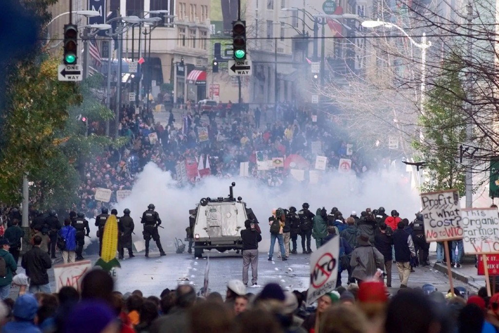 FILE - In this Nov. 30, 1999, file photo, Seattle police use tear gas to push back World Trade Organization protesters in downtown Seattle. The Associ...
