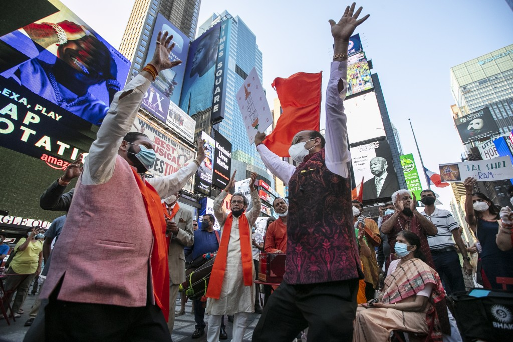 People gather in Times Square after the groundbreaking ceremony of a temple dedicated to the Hindu god Ram by Indian Prime Minister Narendra Modi, Wed...
