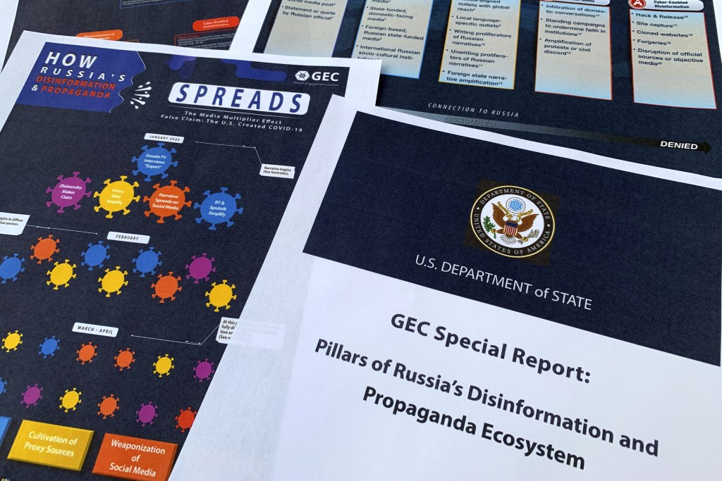 Pages from the U.S. State Department's Global Engagement Center report released on Aug. 5, 2020, are seen in this photo. The State Department says Rus...