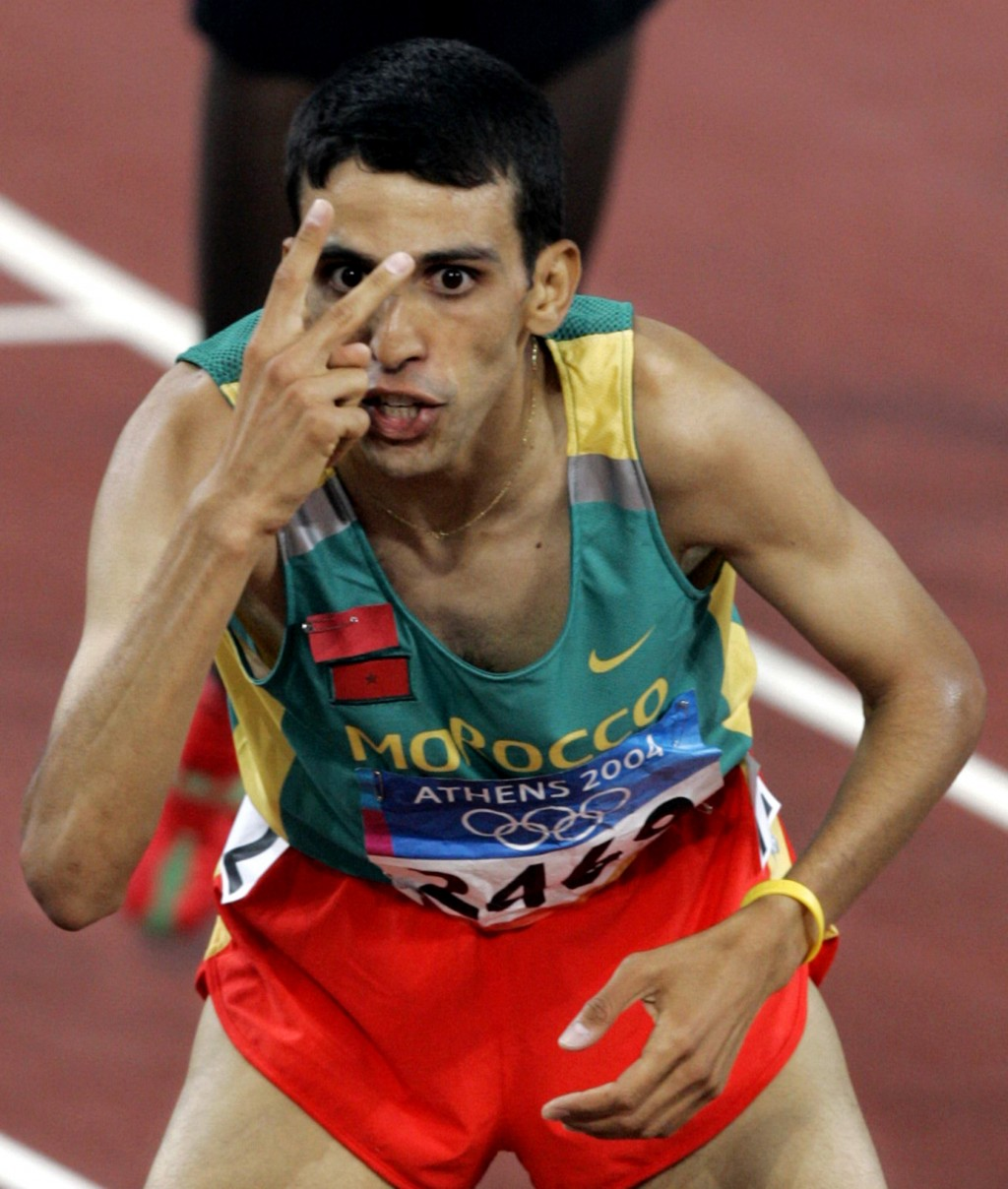 FILE - In this Aug. 28, 2004, file photo, Morocco's Hicham El Guerrouj celebrates after winning the gold medal in the 5000-meter final, his second gol...