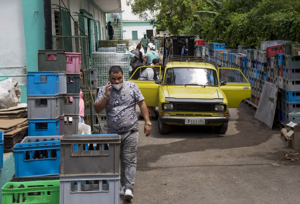 Customers enter through the back of Mercabal wholesale market, to load their merchandise in Havana, Cuba, Thursday, July 30, 2020. The government is l...