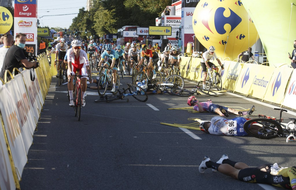 Cyclists are injured in a crash on the final stretch of the opening stage of the Tour de Pologne race in Katowice, Poland, on Wednesday, Aug. 5, 2020....