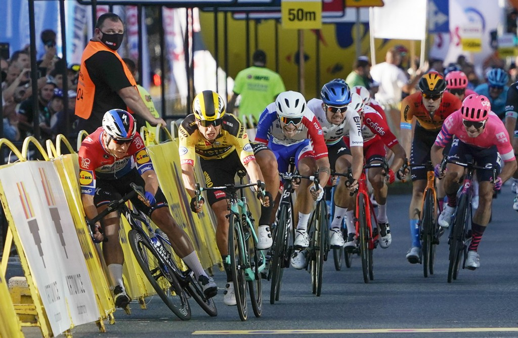 Sprinting for the win Dutch cyclist Fabio Jakobsen, left, hits side barriers at the start of a crash with his countryman Dylan Groenewegen, 2nd left, ...