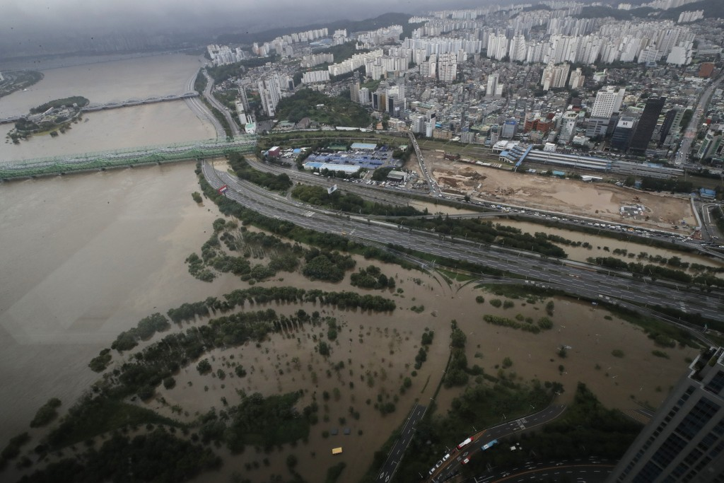 A part of a main road and a park near the Han River are flooded due to heavy rain in Seoul, South Korea, Thursday, Aug. 6, 2020. Torrential rains cont...