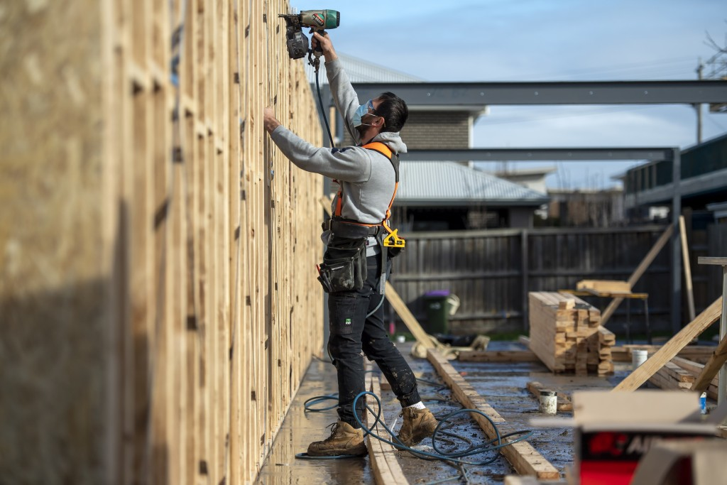 A builder works a on a construction site during lockdown due to the continuing spread of the coronavirus in Melbourne, Thursday, Aug. 6, 2020. Victori...