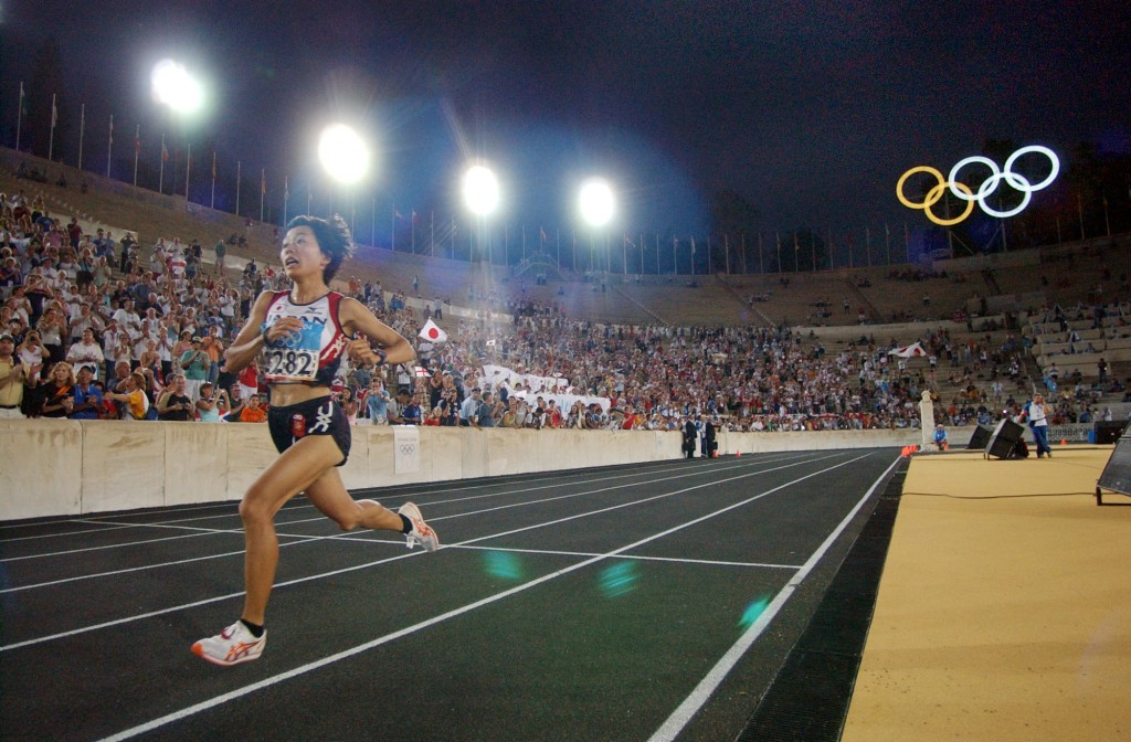 FILE - In this Aug. 22, 2004, file photo, Japan's Mizuki Noguchi takes the final lap inside the Panathinaiko Stadium as she wins the gold medal in the...