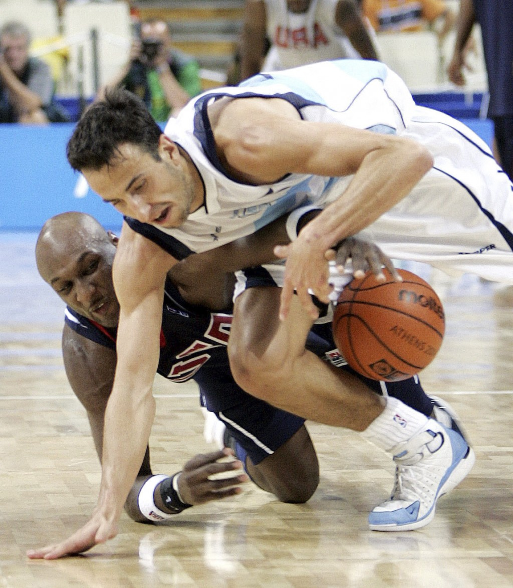 FILE - In this Aug. 27, 2004, file photo, Argentina's Emanuel Ginobili, top, battles the USA's Lamar Odom for the ball late in the fourth quarter of s...